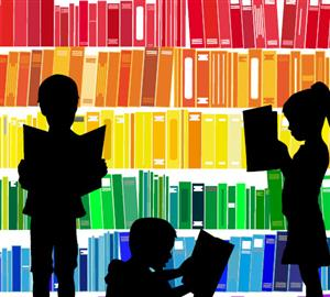 children reading in front of color