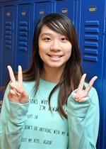 student using peace signs